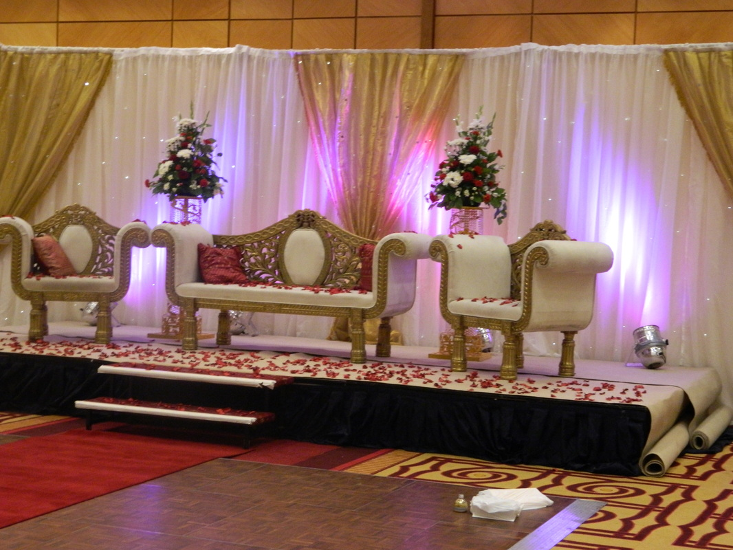 Indian wedding stage in gold and red at london marriott for Asian wedding stage decoration london